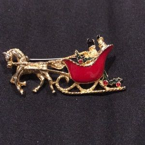 Vintage Christmas couple in red sleigh